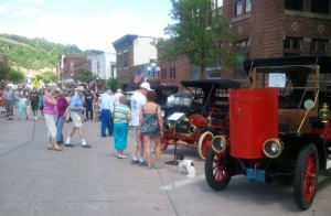 Genny has a place with some of his elders at the Red Wing, Minnesota  Father's Day car show.